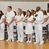 Mount Wachusett Community College Nursing students stand for the National Anthem during the pinning ceremony held on Thursday evening. SENTINEL & ENTERPRISE / Ashley Green