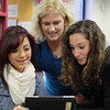 Students participate in the Mount Wachusett Community College Access & Transition programs at Fitchburg High School. Aid for Educational Talent Search Kathleen Waite, center, wotks with FHS sophomore Texa Mezquita, 16, and freshman Brianna Borey, 15, at the program on Tuesday. SENTINEL & ENTERPRISE/JOHN LOVE