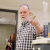 Professor Fred Fitzpatrick demonstrates what happens when he created and oscillating reaction during the Mount Wachusett Community College's STEM Starter Academy on Friday morning in Gardner. SENTINEL & ENTERPRISE/JOHN LOVE