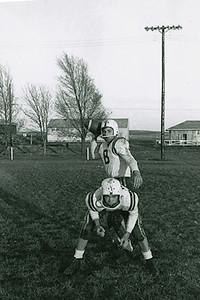 1957-10 - QBack Ray Wendell, Center Dwaine Voas