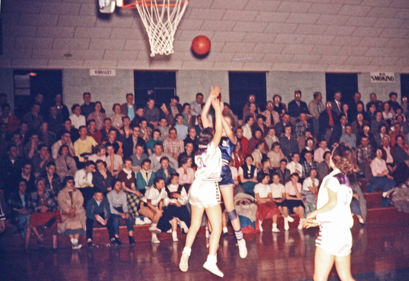 1957-02 - Judy Speke shooting over Pierson guard