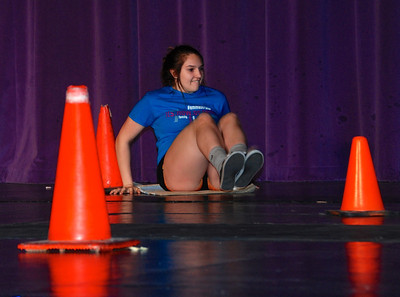 Minute to Win It: Scooting around the cones.