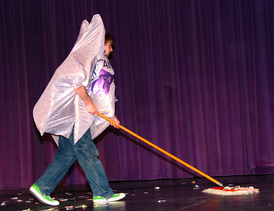 Sweeping up the stage.