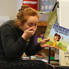 Representatives from  Lowell Family Dental Practice visit kindergarden students at Murkland Elementary School. Kindergarten teacher Hillary Millett begins reading a funny book after the dental visit. (SUN/Julia Malakie)