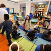 Patient coordinator Krystle Boucher of Lowell, from Lowell Family Dental Practice, leads half the students, playing sugar dancers, in between the other half of students playing sleeping teeth, during a visti with kindergarden students at Murkland Elementary School. (SUN/Julia Malakie)