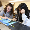 """Students work on projects in the middle school STEAM classroom at Notre Dame Academy. Eighth graders Kelsey Branco, 14, of Hudson, N.H., and Victoria Bui, 14, of Lowell, work on their version of Van Gogh's """"Starry Night.""""  The project was programming moving parts and lights into a famous work of art. (SUN/Julia Malakie)"""