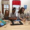 """Students work on projects in the middle school STEAM classroom at Notre Dame Academy. From left, 8th graders Ava Conroy, 14, of Lowell, and Molly Shanahan, 14, of Dunstable, watch Jessica Maina, 13, of Haverhill, Sophia Creegan, 13, of Lowell and Lindsay Baquerizo, 14, of Tewksbury, work on their version of Roy Lichtenstein's """"Crying Girl."""" The project was programming moving parts and lights into a famous work of art. (SUN/Julia Malakie)"""