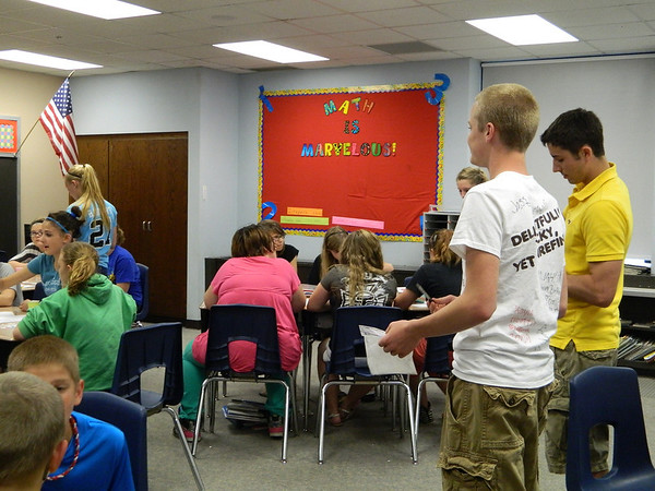 NDHS FFA members do an agriculture presentation for Mrs. Brown's sixth grade class.