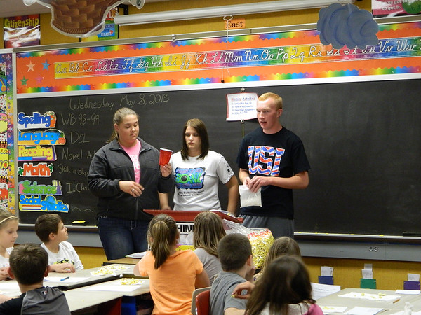 NDHS FFA members do an agriculture presentation for Mrs. Kramer's third grade class.