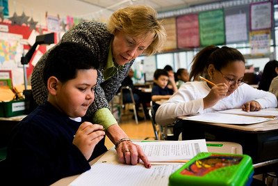 Jacquleine Dunn helps Jonathan Rodriguez and other other students in her 4th grade DRP class at Conte-West Hills get ready for the upcoming CMTs