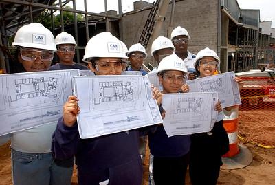 Beecher Constructin #5;  Students got floorplans of their new svchool during a visit to the Beecher School construction site.  Front row L-R:  Latricia DeRoche, Peter Jace, Alberto Matias and Ileana Alvarez