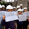 Beecher Constructin #5;  Students got floorplans of their new svchool during a visit to the Beecher School construction site.  Front row L-R:  Latricia DeRoche, Peter Jace, Alberto Matias and Ileana Alvarez