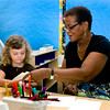 Three-year-old Thea Bassett gets help with aproject from Shirley Gray during a class at the newly opened preschool program at Celentano.