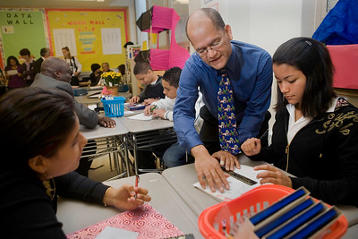 NHPS 2007 Teacher of the Year Luis Rosa helps two of his students from FHMS: Delia Sulca and Midalys Acevedo with a math problem.