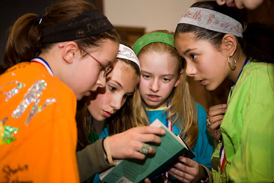 """The second-place Betsy Ross """"Bella Books"""" Book Bowl team prepare a challenge during the middle school final in January.  L-R:  Erica Noonan, Josie Kulp, Lucy Robinson and Orianna Cruz.  A member of the squad, Lisa Chiplinsky is not pictured."""