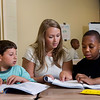 Para-professional Amanda Blazejewski works with third-graders Aniello Cappetta and Rodney Jordan during sSummer School classes at Ross Woodward School in July.  We need to double-check Rodney's photo permission slip.