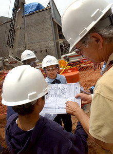 Beecher Visit:  Beecher School project supervisor Fred Smith, right,  speaks to   sixth-graders Peter Jace, Ileana Alvarez and other students  about the construction project during a visit to the site Monday in New Haven