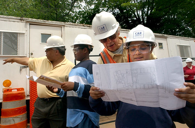 Beecher Construction #2:  Beecher School project supervisor Fred Smith, right,  speaks to   Ross-Woodward sixth-grader Peter Jace during a visit to the site Monday in New Haven