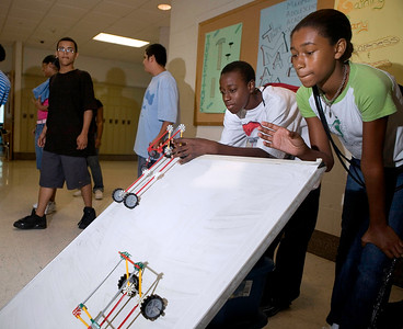Ninth grader Terick Lewis and Dayshea Sykes put vehicles of their own design through time trials during a GEAR UP class at Hill Regional 8/2/07.