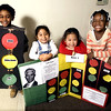 Students from Zigler Head Start show off their Black History Month project on Garrett Morgan, the inventor of the traffic signal.  The students are, left to right: Omarion Gantt, Ashley Rojas, Ping Ting Chen and Anajah Williams.