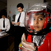 Six-year-old Shatha Khashab models a spacesuit designed by her brother Khashab Khashab (far left) and his classmate Mahir Rana, students at Sheridan, for a competition judged by engineers from Hamilton Sundstrand Tuesday in New Haven.