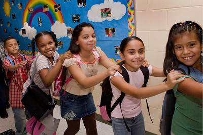 Second and third graders congo their way to their new classrooms during the Jepson grand opening in September.  picture number seven from left to right is  Christan Gonzalez (the boy in red) Syan Washington, Talajah Crnkovic, Angelica Rodriguez, and Laura Bedoya. The girls are all in third grade and the young man is in second grade. They are all in my classroom