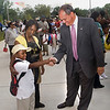 Troup students greet the Mayor as they prepare to enter their new school.