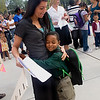 First grader Vance Taylor gives a big hug to his teacher Tara Nutile on the first day of classes in the new Troup School, 2008