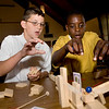 AJ Consiglio and Emmanuelle Chatman, sixth graders at te new UNH Science and Engineering Magnet School work on a project tigether Friday morning.  The stuents were building Rube Goldberg machines, a project that teaches them about energy transfer, problem solving and teamwork.