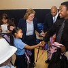 Combus third grader Alejandra Herrera thanks Quinton Bright of the Phi Beta Sigma Fraternity.  The fraternity donated new backpacks to Colombus students during a special assembly to celebrate the first day of classes in the new Colombus School, 2008.
