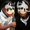 First Graders Heidy Castanon (L) and Giisela Urias sing an animal song  at Fair Haven School.