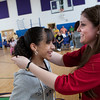 Martinez Math teacher Heather Nixon presents an award to one of the students in her seventh-grade Algebra class, the highest scoring class in the state in the First in Math competition.
