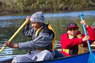 Barnard sixth graders Mikahl Glass and Xavier Segarra canoe on the West River.