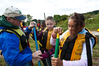 Terry McCool of the NH Parks and Rec Dept gives Barnard sixth graders Jasmine Aviles and Tatianna Naylor some pointers on canoeing during a special workshop.