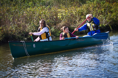 Terry McCool of the NH Parks and Rec Dept takes Barnard sixth graders Tatianna Naylor and Jasmine Aviles on a tour of the West River.