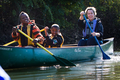 Barnard sixth graders Willie Canty and Robert Franklin canoe on the West River with a teacher.