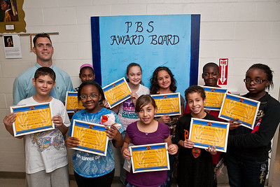 BRAMS principal Shawn True poses with student being honored for exhibiting good behaviour and core values.  Back row Dajavonne Carter-6, Sarah Sugrue-8, Lorraine Vazquez-6, Devon Watson-7 and Infiniti Suggs-7.  Front Row: Alex Castro-8, Nia Gayle-5, Megan Tallberg-5 and Idriss Nasry-6