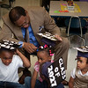 New Haven Public Schools Superintendent Dr. reginald Mayo visits a Clarence Rogers kindergarten during a special event on the first day of classes to encourage students to go to college.