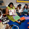 Clarence Rogers kindergarten teacher Tamara Raiford reads to studnts on the first day of classes.