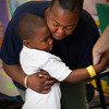 Adria McKnight hugs her son Samar Suggs goodbye on his first day as a kindergarten student at Clarence Rogers School in New Haven