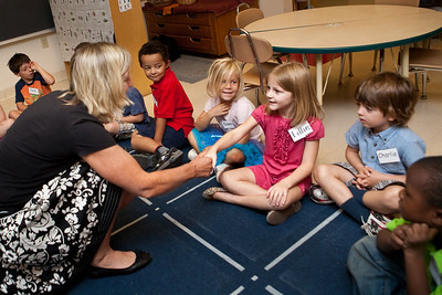 Anne Donnery welcomes Edgewood Avenue kindergarten students to her class on the first day of school.