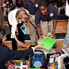 Marna Borgstrom of the YNHH helps students unpack supplies at Hillhouse 9/21/10.