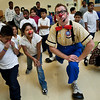 Chris Allison of Ringling Brothers gives alesson in clown fitness to students at John Martinez in New Haven.
