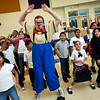 Chris Allison of Ringling Brothers gives alesson in clown fitness to students at John Martinez in New Havens