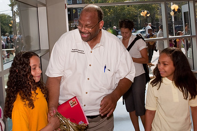 Principal Leroy Williams greets Clemente students as they enter on the first day of classes in their new school building Wednesday.