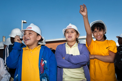 Clemente students cheer as the school's fuel cell is hoisted into position.
