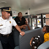 New Haven Assistant Police Chief Ariel Melendez speaks to students at Roberto Clemente about Bus Safety Thursday.