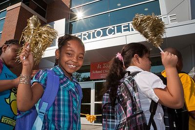 Clemente students cheer during the ribon cutting ceremony on the first day of classes in their new school building Wednesday.