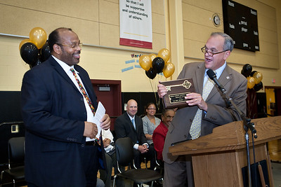 Clemente principal Leroy Williams recieves the official key to the school from the Mayor during the Dedication Ceremony for the new Clemente School.