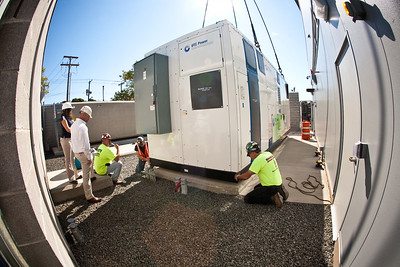 Workers install the city's newest fuel cell at the Clemente Leadership Academy.